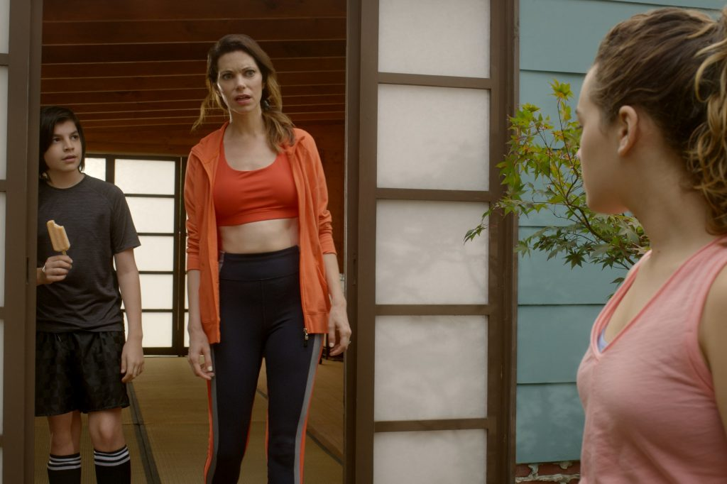 Cobra Kai star Courtney Henggeler in workout clothes with her kids