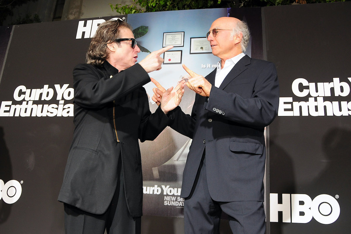 Richard Lewis and Larry David arrive at a red carpet event in 2009
