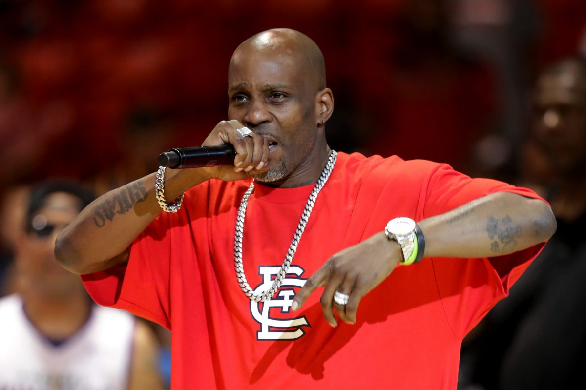 DMX performing at the BIG3 in a red shirt and silver jewelry.