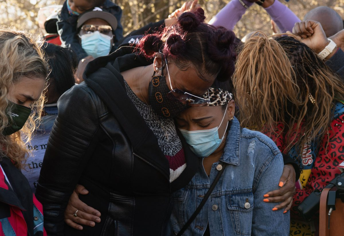 Tashera Simmons and Desiree Lindstrom embrace each other at a memorial for DMX in April 2021.