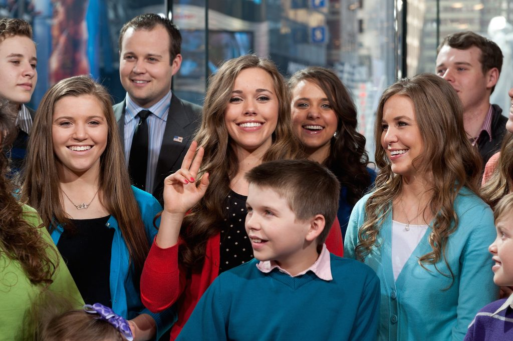 The Duggar family surrounding Jessa Duggar while on the set of 'Extra' preparing to offer Duggar news to the entertainment company