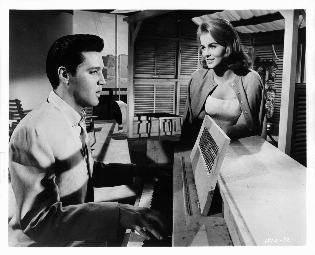 Ann-Margret watches Elvis Presley play the piano in a scene from the film 'Viva Las Vegas', 1964.