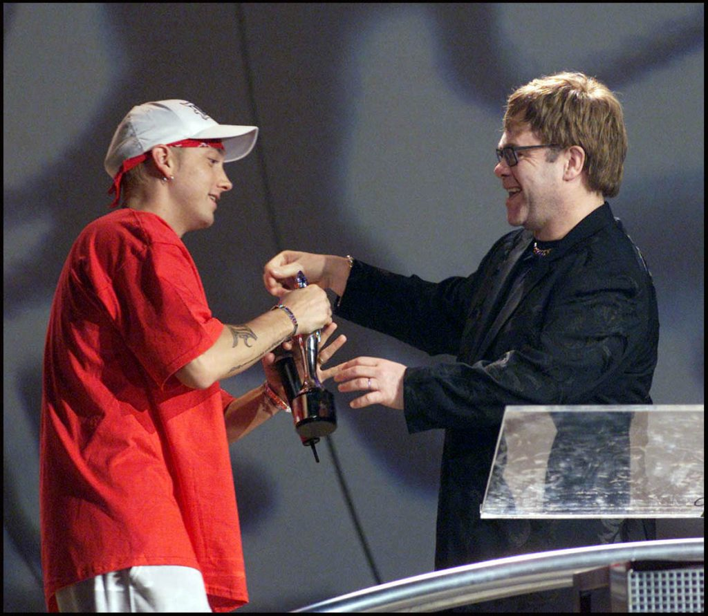 Eminem accepts award from Sir Elton John at the 2001 Brit Awards
