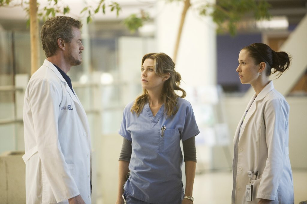 Eric Dane, Ellen Pompeo, and Chyler Leigh in scrubs in a scene from 'Grey's Anatomy'
