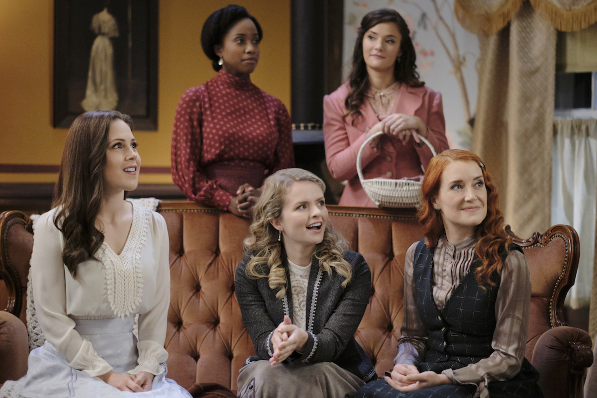 Elizabeth and other Hope Valley women sitting on couch at Florence's bachelorette party in When Calls the Heart