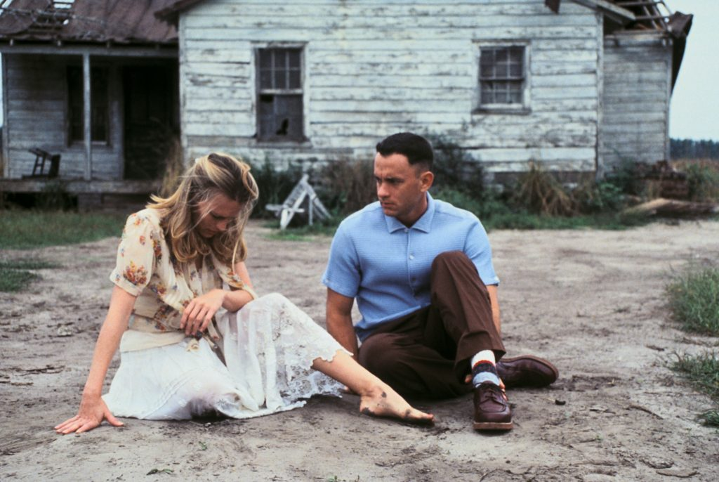 Jenny and Forrest Gump sit in the dirt