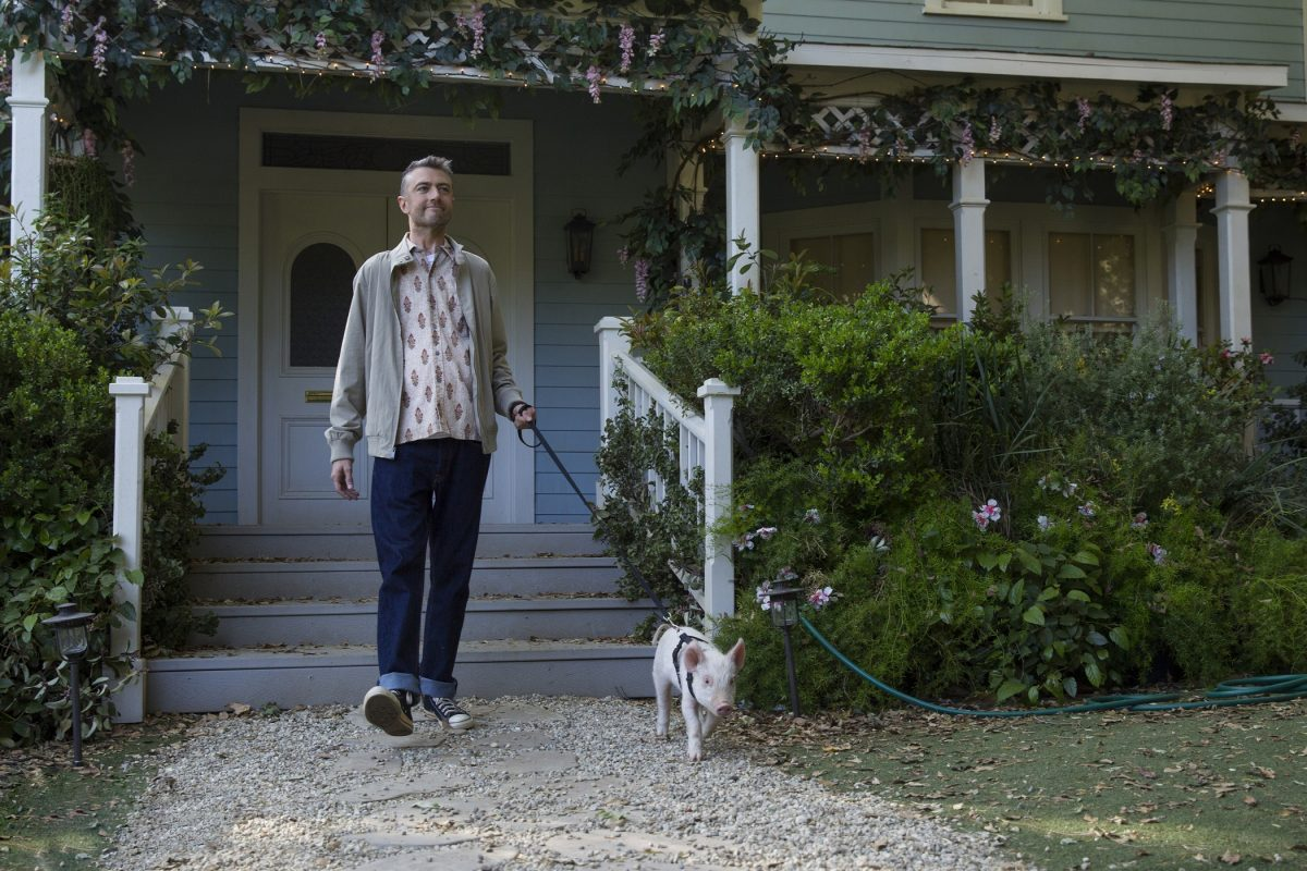Sean Gunn as Kirk Gleason leaves Lorelai's house with his pet pig in 'Gilmore Girls: A Year in the Life'