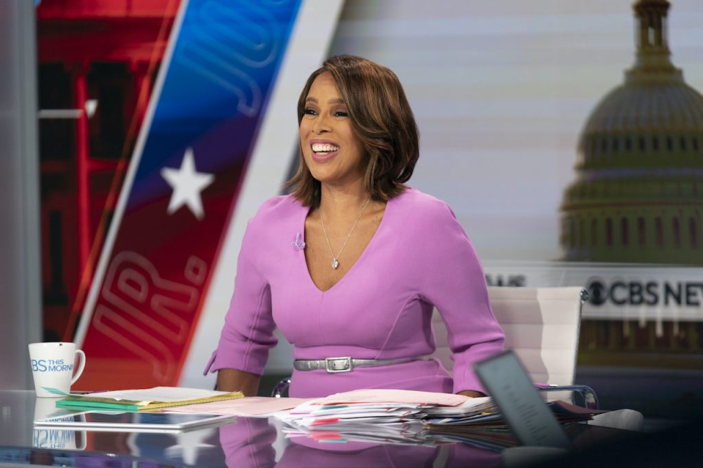 'CBS This Morning' co-host Gayle King smiling in a pink dress at the news desk and broadcasts live from Washington, D.C.