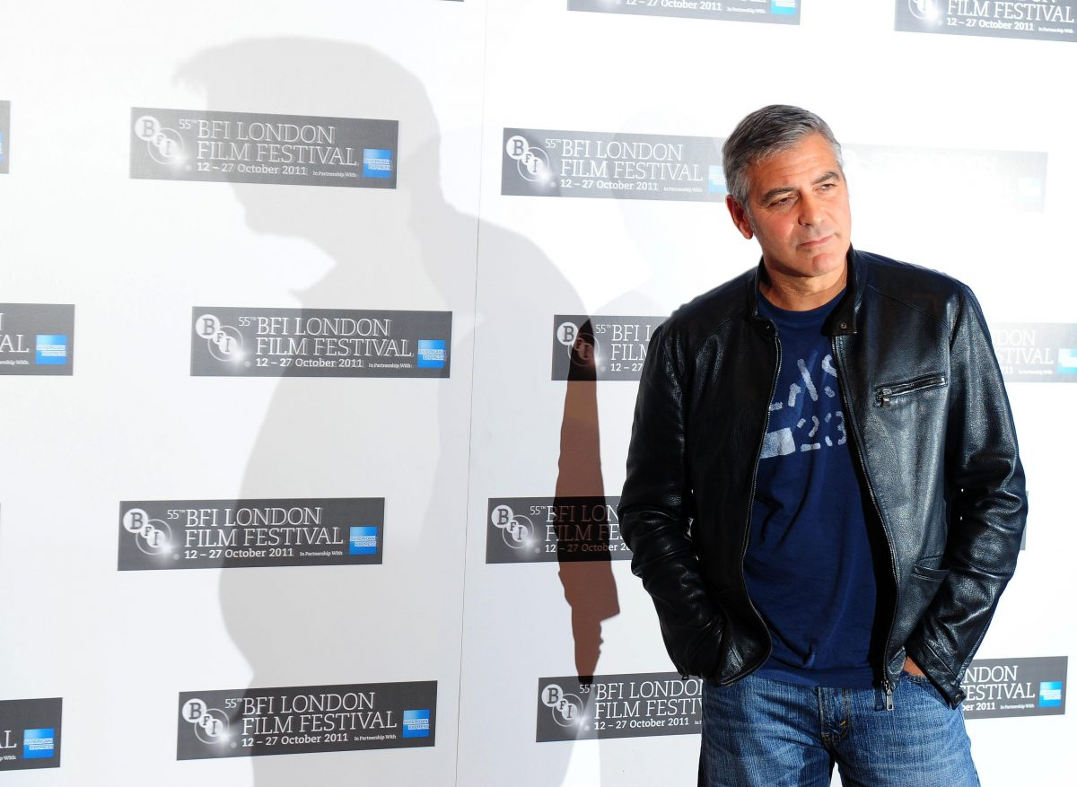 George Clooney posing for photographers at the BFI London Film Festival.