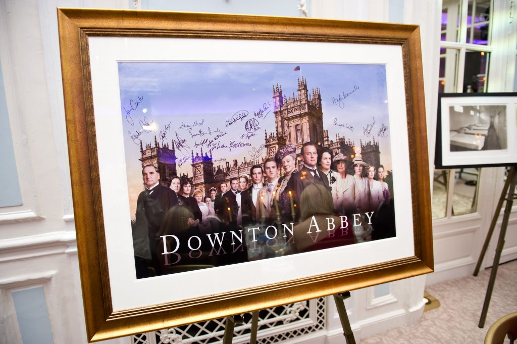 A signed and framed promotional poster for 'Downton Abbey'