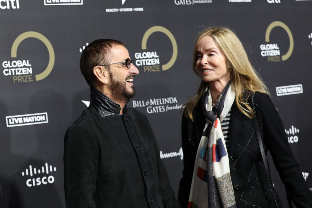 Former Beatle Ringo Starr and his wife Barbara Bach stand smiling at one another during the 2019 Global Citizen Prize at the Royal Albert Hall in 2019