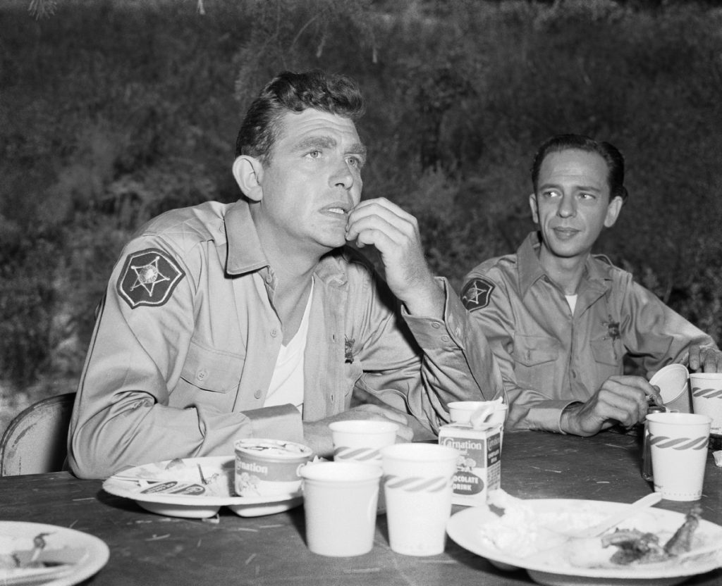 Andy Griffith and Don Knotts relax after a meal on the set of 'The Andy Griffith Show,' 1960