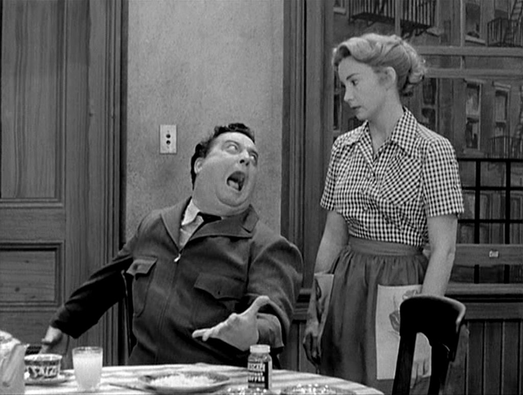 Jackie Gleason as Ralph Kramden and Audrey Meadows as Alice Kramden in a scene from 'The Honeymooners' television comedy, 1955