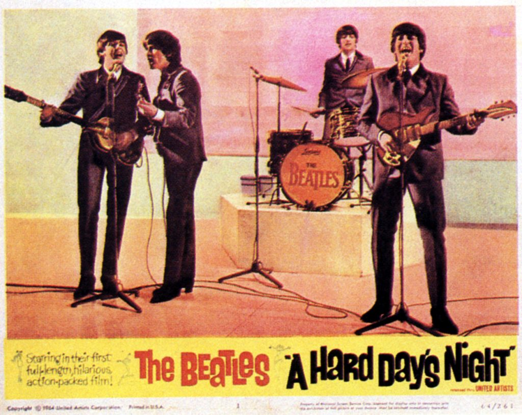 A promotional poster for The Beatles 1964 film 'A Hard Day's Night' shows the band performing on stage