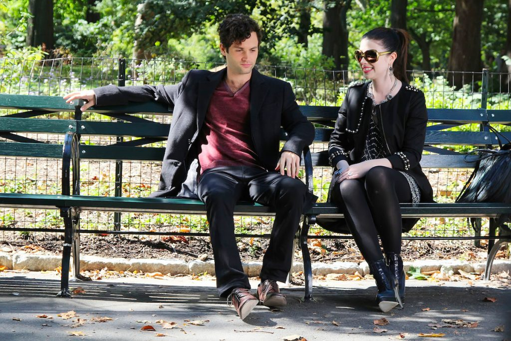 Michelle Trachtenberg and Penn Badgley are seen on set of 'Gossip Girl' sitting on a park bench
