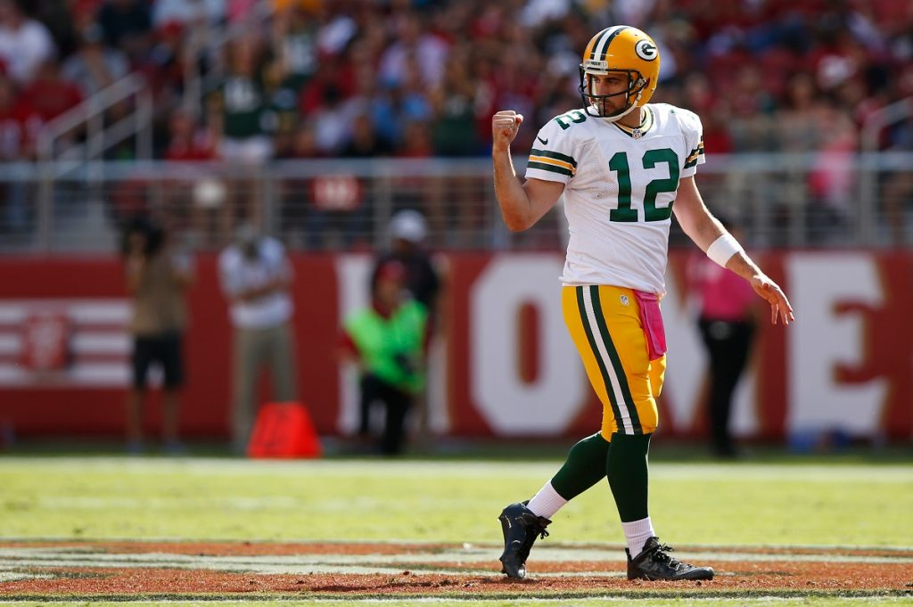 Green Bay Packers quarterback Aaron Rodgers fist pumps in the air during game