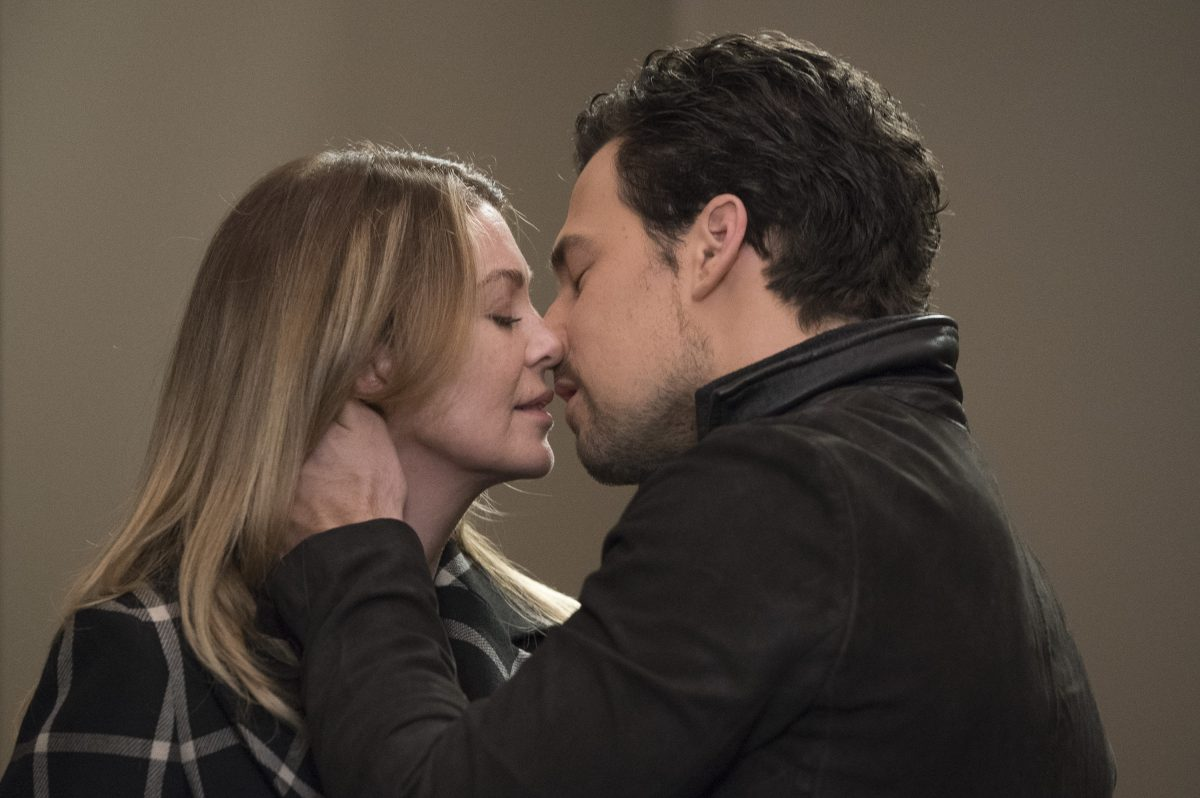 Grey's Anatomy stars Ellen Pompeo as Meredith and Giacomo Gianniotti as DeLuca kissing.