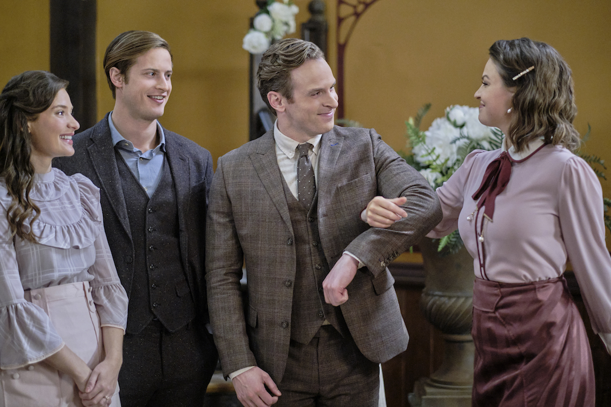 Hickam takes Fiona's arms as Clara and Jesse look on in When Calls the Heart