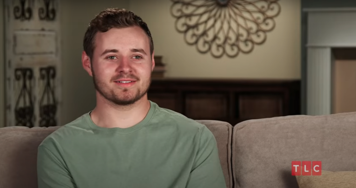 Jed Duggar sitting on a couch in episode of Counting on