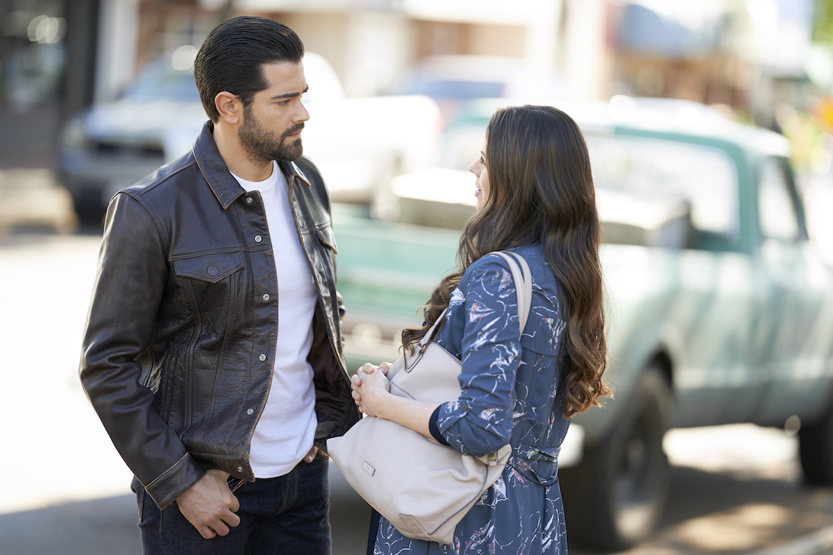 Jesse Metcafle standing on street and talking to Meghan Ory in Chesapeake Shores