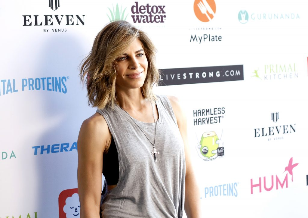 Jillian Michaels in a gray shirt smiles for cameras as she attends the Livestrong.com's 1st annual STRONGER Weekend Retreat at Rose Bowl