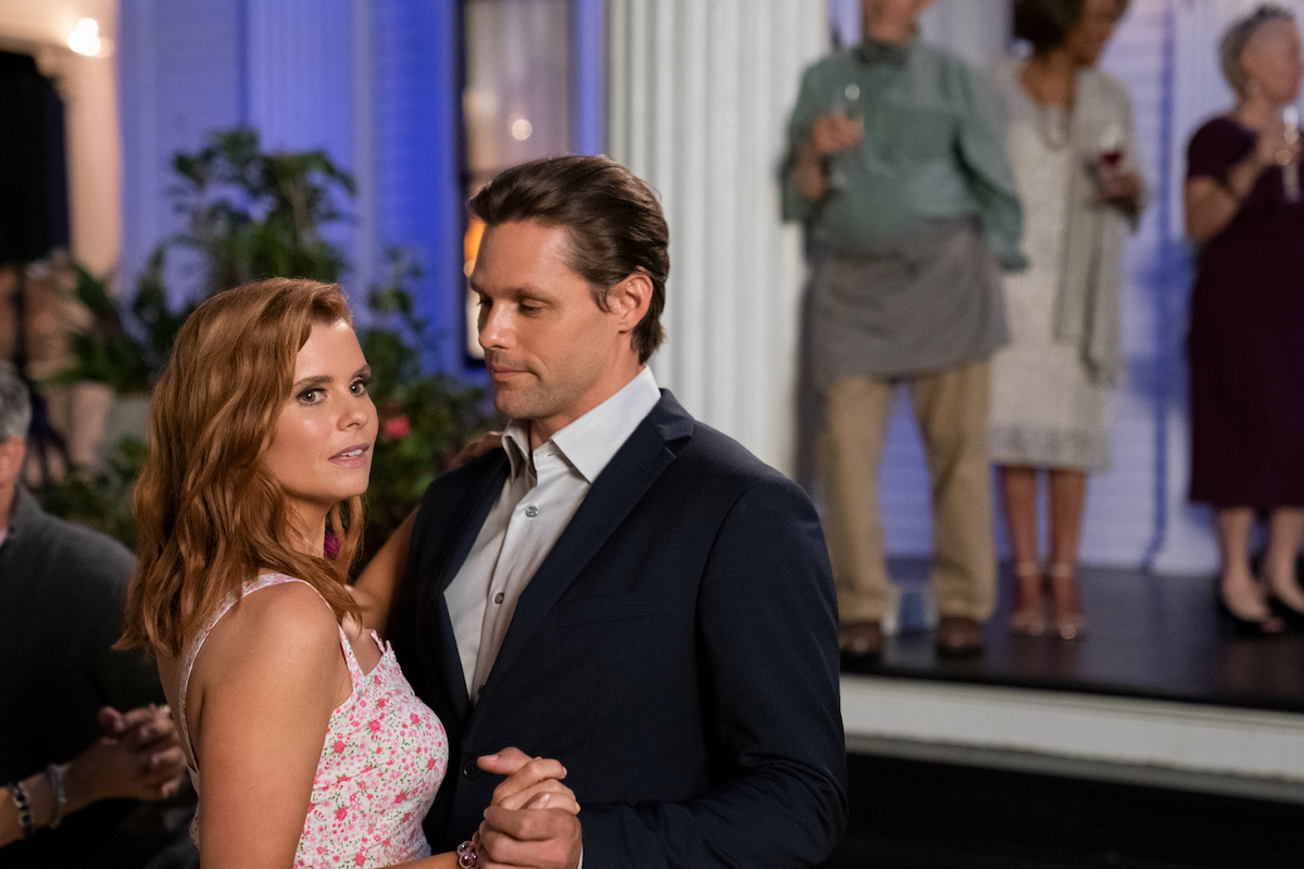 JoAnna Garcia Swisher and Justin Bruening dancing together in Sweet Magnolias