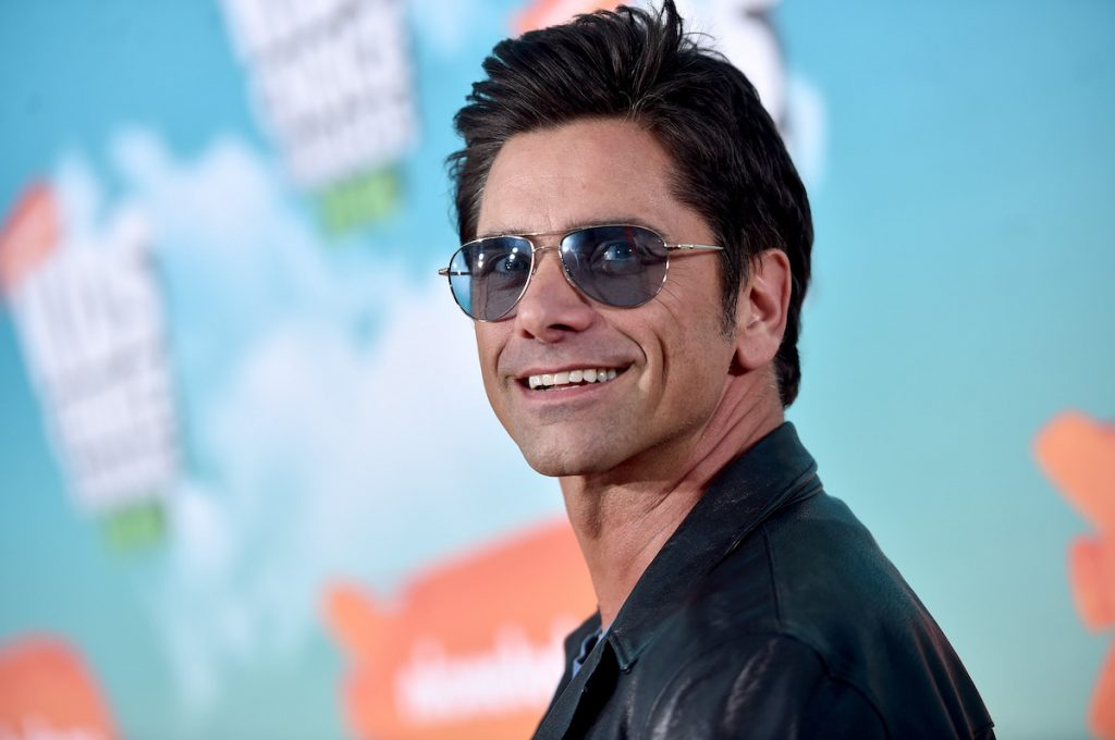 John Stamos wears sunglasses and smiles