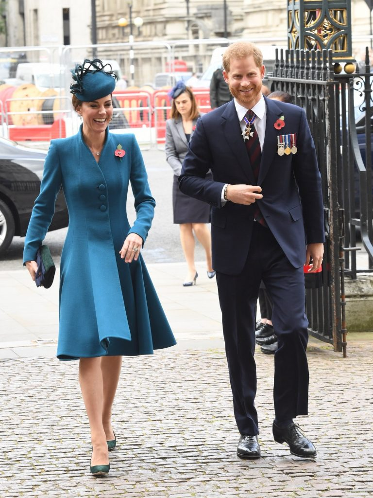 Kate Middleton and Prince Harry laughing together as they walk into Westminster Abbey for an event in 2019