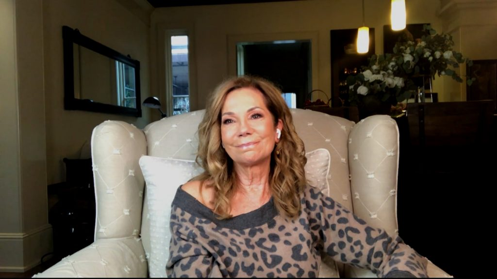 Kathie Lee Gifford in a spotted top sitting in a beige chair