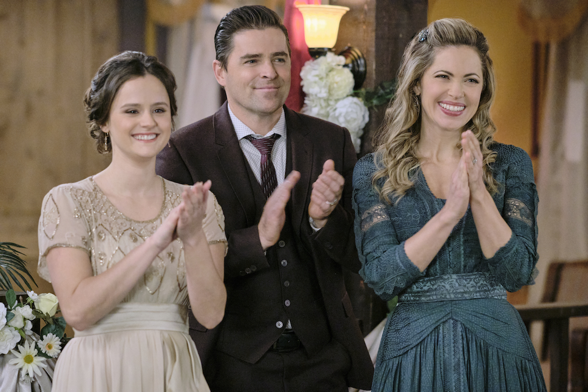 Katie, Lee and Rosemary clapping in When Calls the Heart