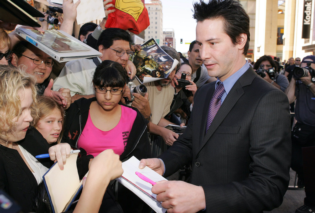Keanu Reeves visits with fans at his Hollywood Walk of Fame ceremony in 2005 in Hollywood, Calif.