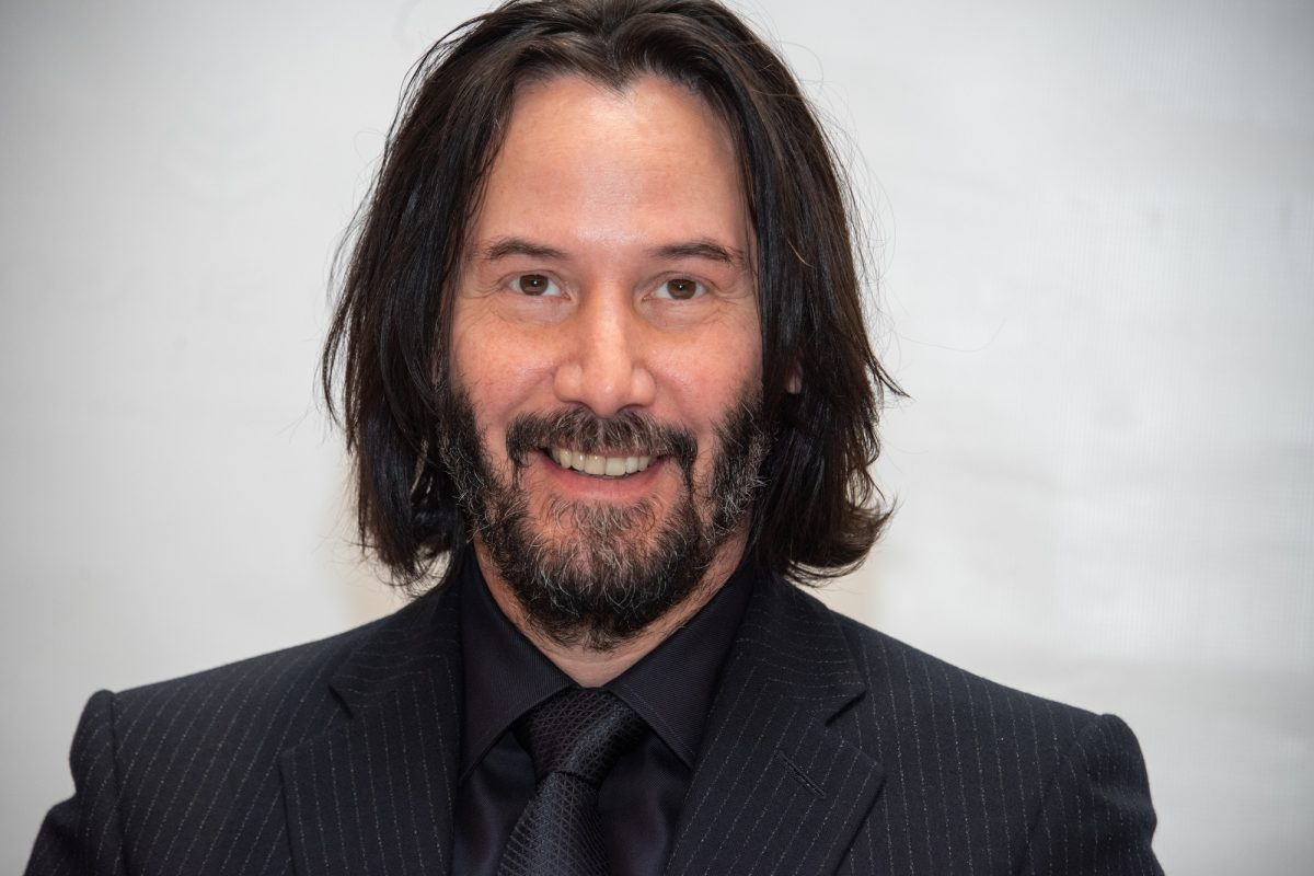 Keanu Reeves smiles at the John Wick 3 press conference