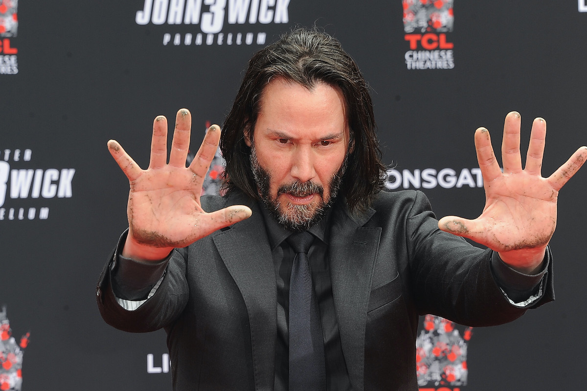 Keanu Reeves places his handprints in cement at TCL Chinese Theatre IMAX Forecourt in Hollywood, Calif. in 2019