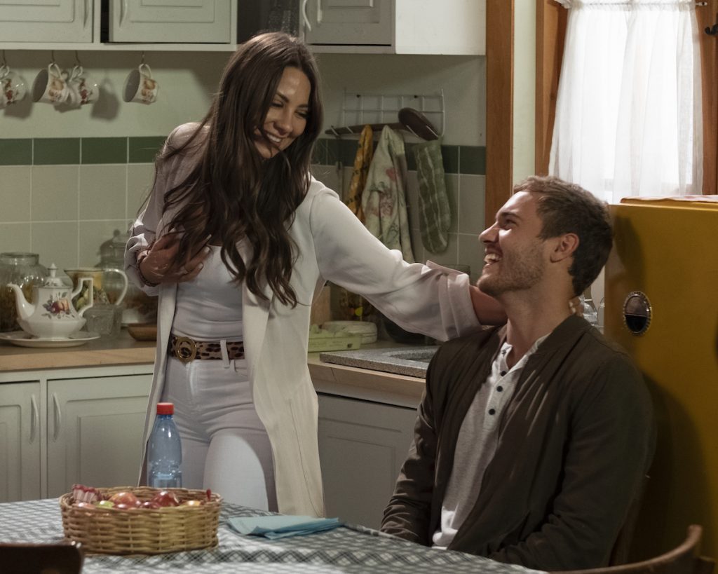 Kelley Flanagan in a white outfit with her arm on Peter Weber from 'The Bachelor'