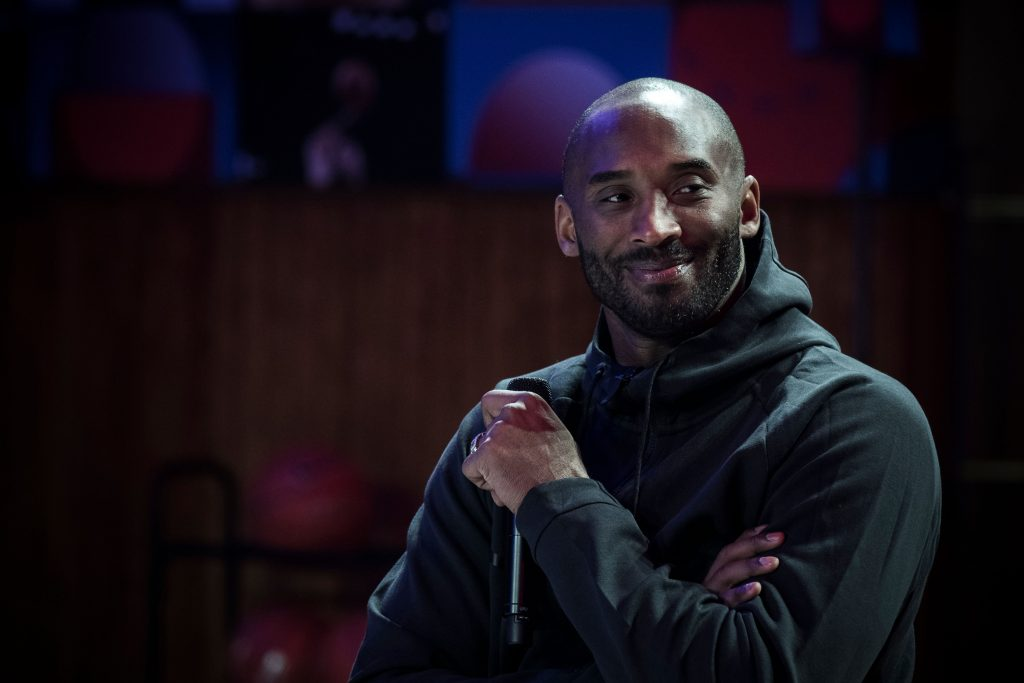 Late NBA player Kobe Bryant smiling at a promotional event organized by Nike