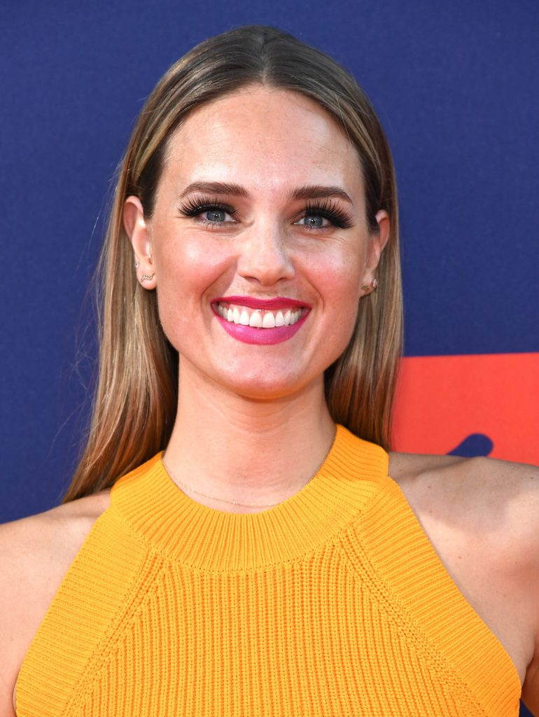 Laurel Stucky from MTV's 'The Challenge' smiling at the camera at an awards show. She's wearing a yellow dress
