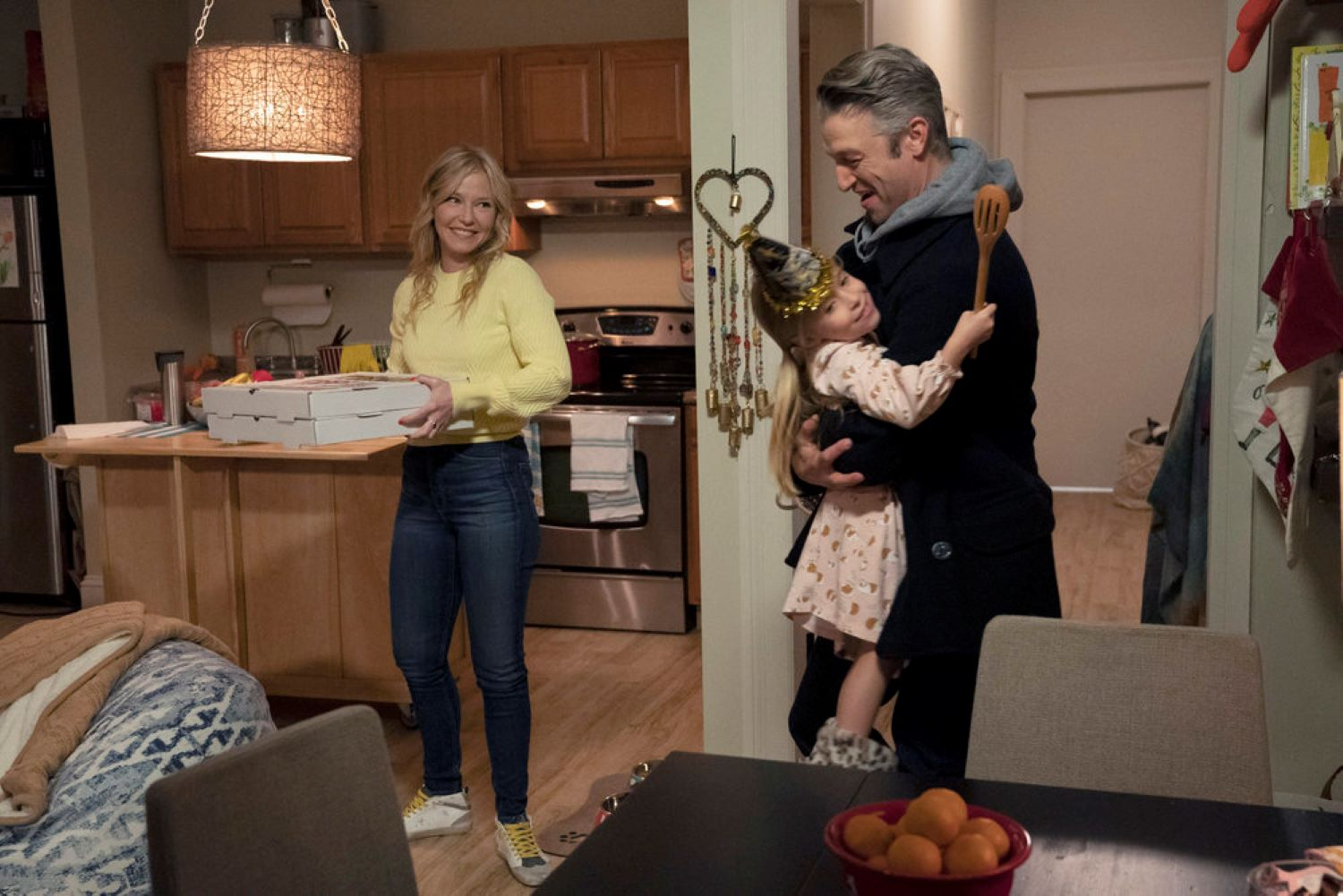 'Law & Order: SVU' (l-r) Kelli Giddish as Detective Amanda Rollins, Charlotte and Vivian Cabell as Jesse Murphy Rollins, Peter Scanavino as Assistant District Attorney Sonny Carisi