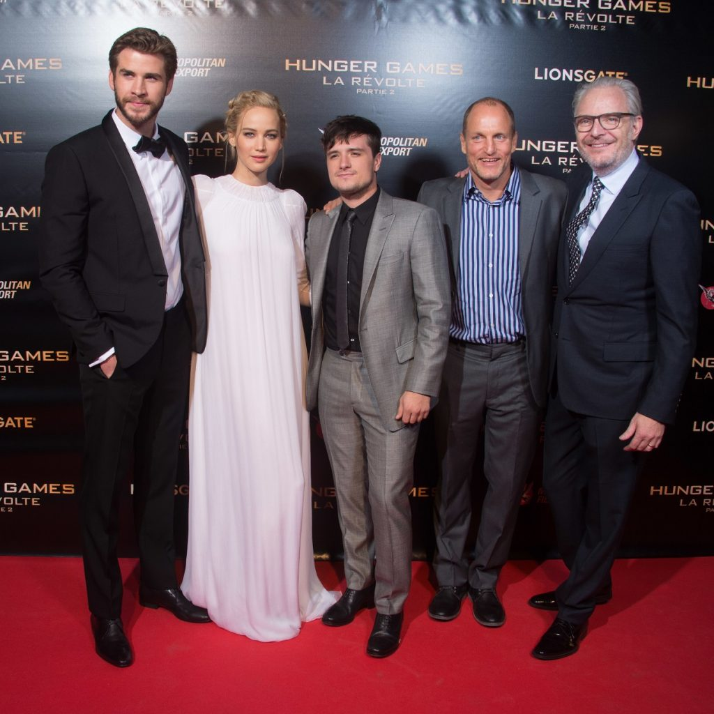 Liam Hemsworth, Jennifer Lawrence, Josh Hutcherson, Woody Harrelson, and Francis Lawrence at The Hunger Games Mockingjay Part 2 premiere in Paris