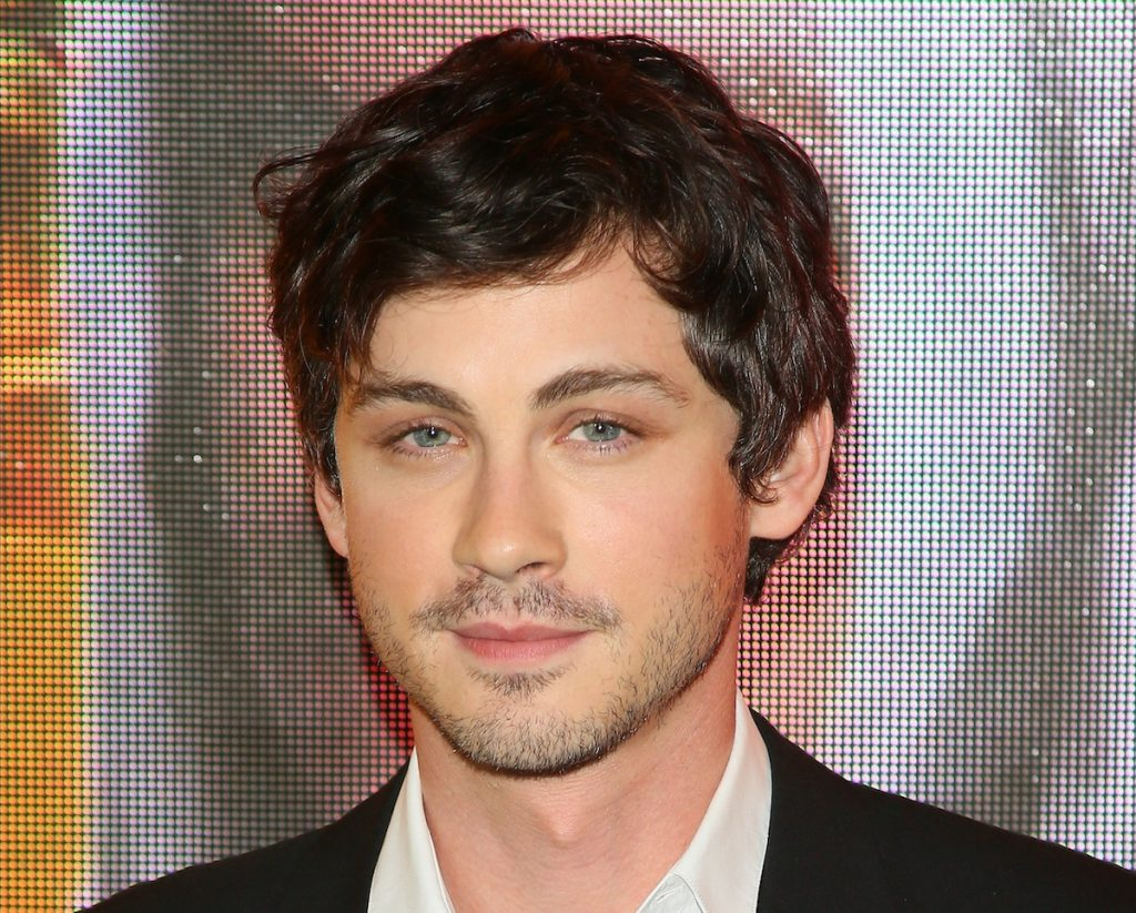 Logan Lerman attends the premiere of Amazon Prime Video's 'Hunters' in a black suit and white shirt