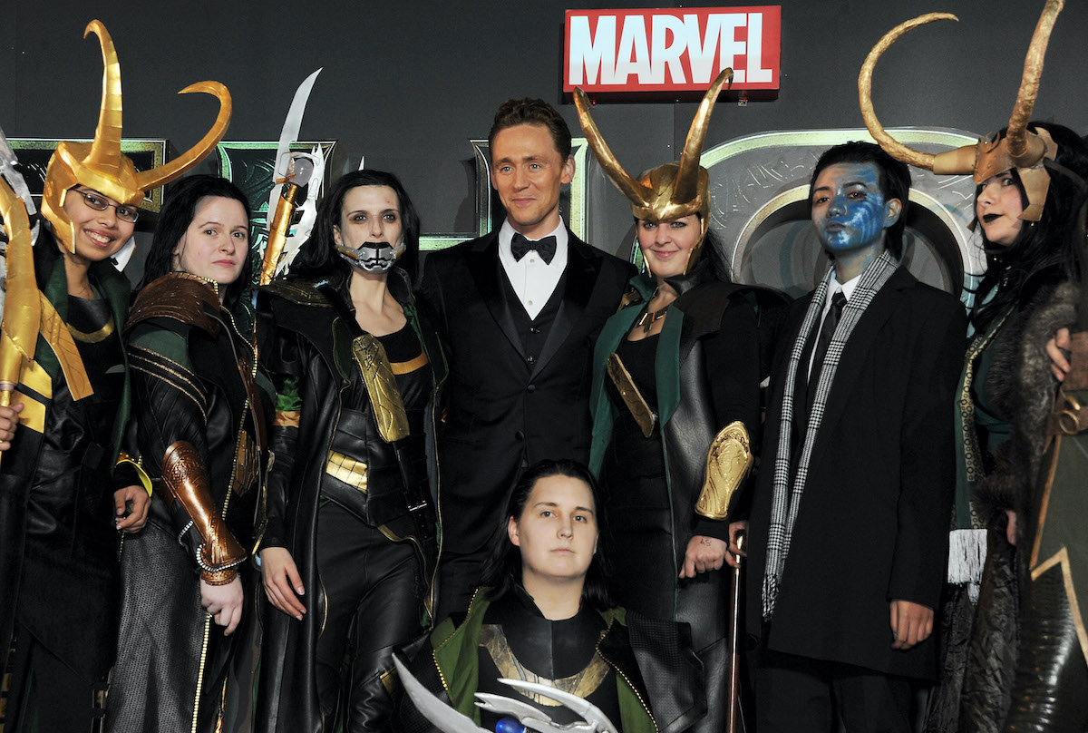 Tom Hiddleston poses with Looki-Loki's at the World Premiere of 'Thor: The Dark World' in London