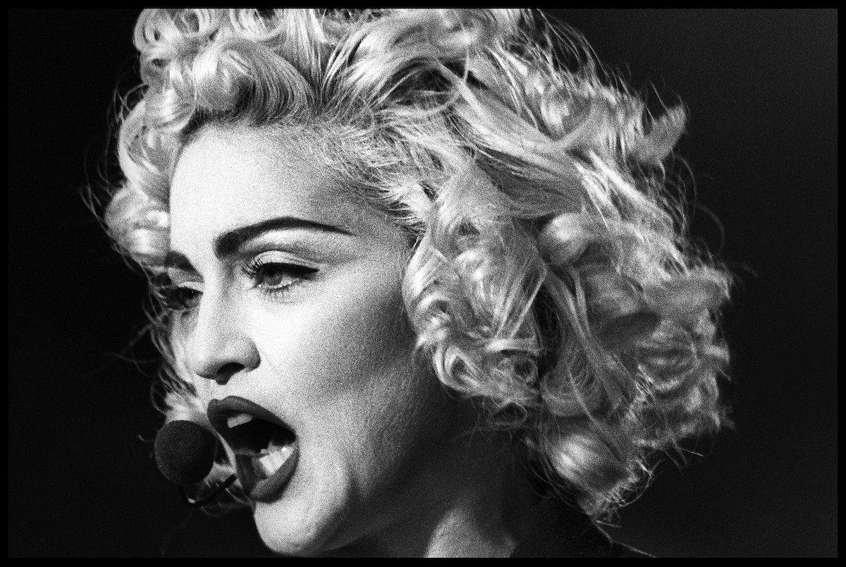 black and white close up photo of Madonna performing during the Blond Ambition tour