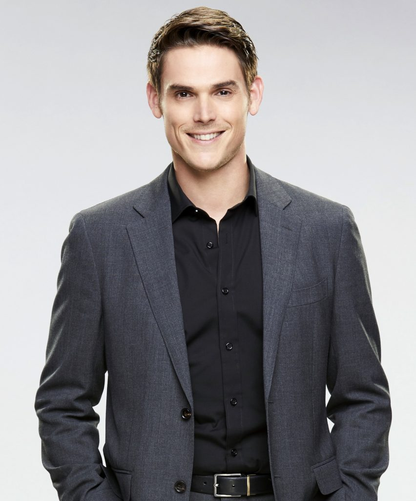 Mark Grossman smiling in front of a white background