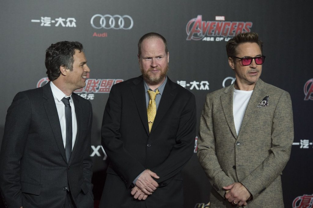 Mark Ruffalo, Joss Whedon and Robert Downey Jr stand next to each other on the red carpet.