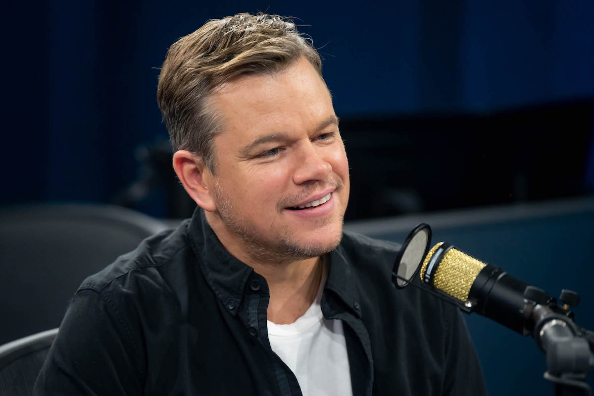 Matt Damon smiles as he speaks into a microphone during a visit to SiriusXM's Hollywood studios in 2019