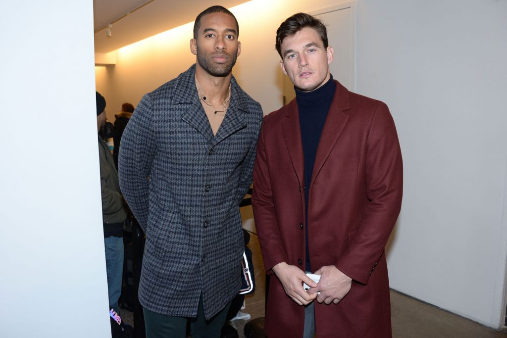 Matt James from 'The Bachelor' and Tyler Cameron from 'The Bachelorette' standing together at a fashion show