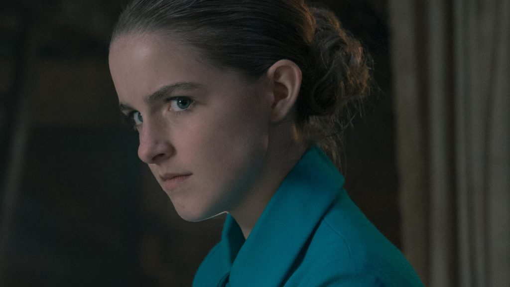 """McKenna Grace as Mrs. Esther Keyes forces Madeline Brewer as Janine to eat in 'The Handmaid's Tale' Season 4 Episode 1, """"Pigs."""""""