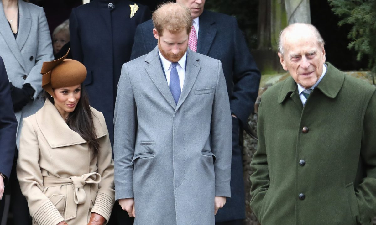 Meghan Markle, Prince Harry, and Prince Philip standing outside Church of St Mary Magdalene following Christmas Day Service in 2017