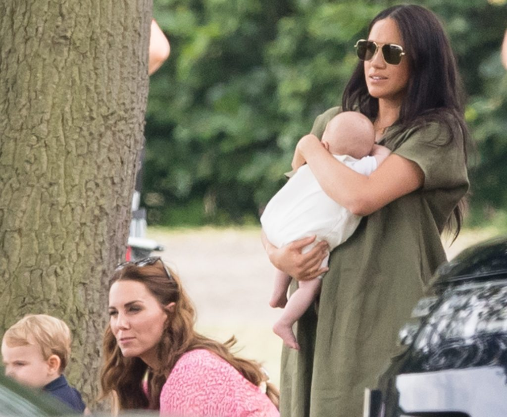 Meghan Markle and Kate Middleton in the park with their children as they watch their husbands play charity polo match