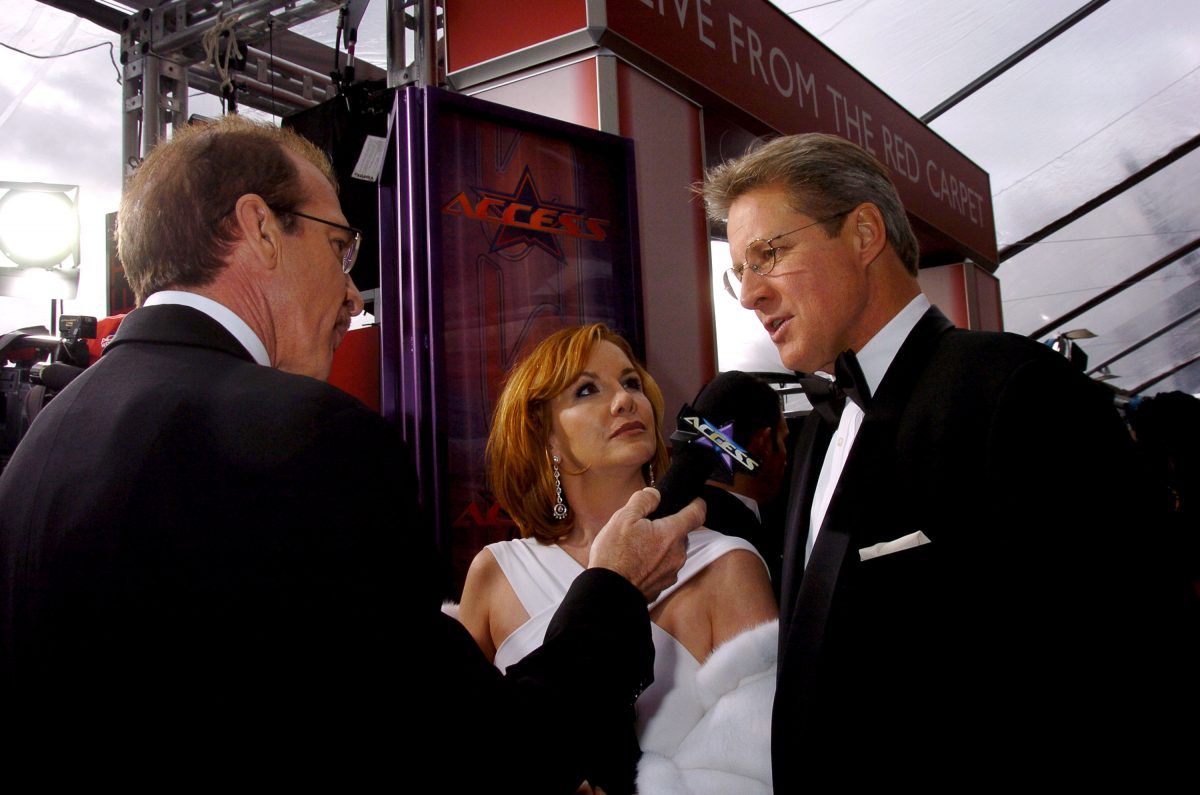 Melissa Gilbert and Bruce Boxleitner getting interviewed on the red carpet.