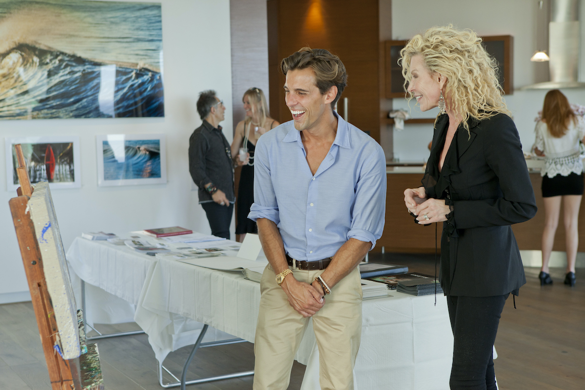 Madison Hildebrand and a blonde woman smile and laughing on Million Dollar Listing Los Angeles